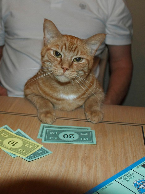 Tigger playing Monopoly
