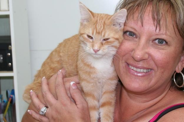 Bad Cat Chris at adoption center with Rose.